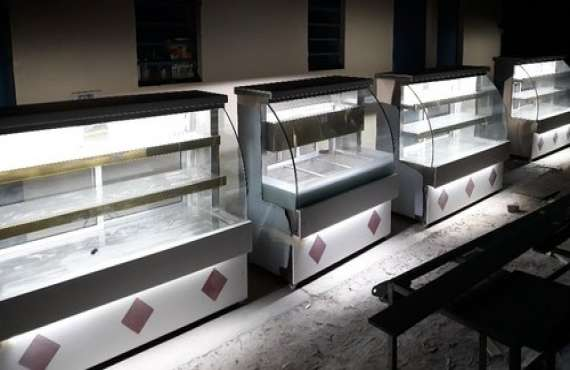 Corian Sweet Display Counter | Yash Projects Fabrication Co. | Corian Sweet Display Counter Manufacturer in mohali - GLK2789