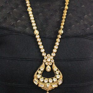 kundan Embellished Long Necklace Set online | IndiHaute | Kundan long necklace set online, Kundan necklace set with jhumka ,  kundan necklace set wholesale price , kundan long necklace set for women , Wedding kundan set  , wedding kundan set online  - GL44422