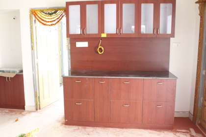 Triad Interio, manufactures of Modular kitchen, wardrobes, L-Shaped wardrobes, glass doors wardrobes, crockery, pooja, beds, partition, Tv unit's ,Balcony unit and shoe rack.